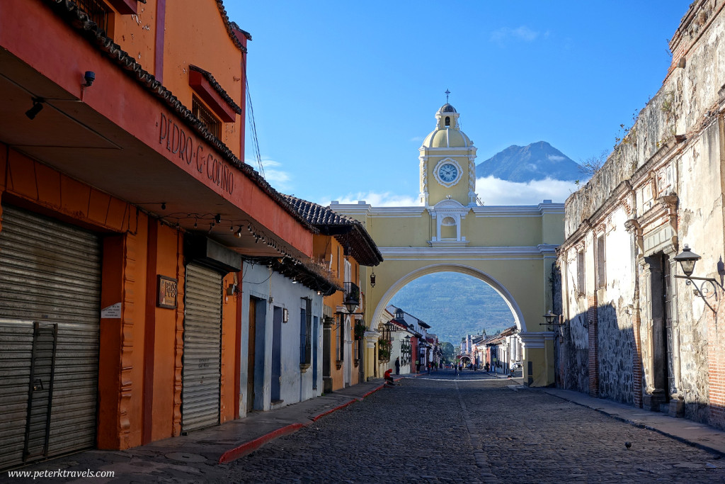 Early morning street view with Arco Santa Catalina and Volcan Agua, Antigua Guatemala