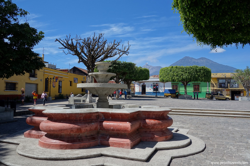 Square with Volcan Fuego in the distant background.