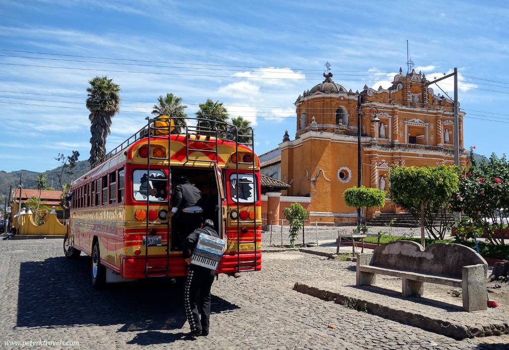 Band members board a chicken bus, San Pedro Las Huertas