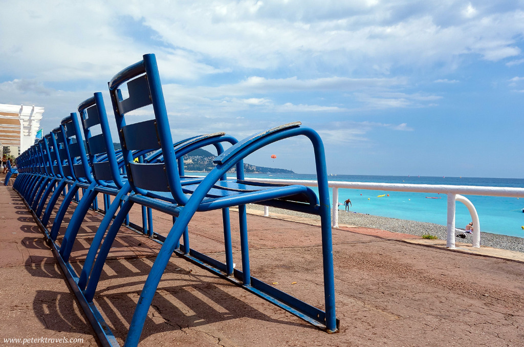 Blue chairs along Nice's Promenade des Anglais