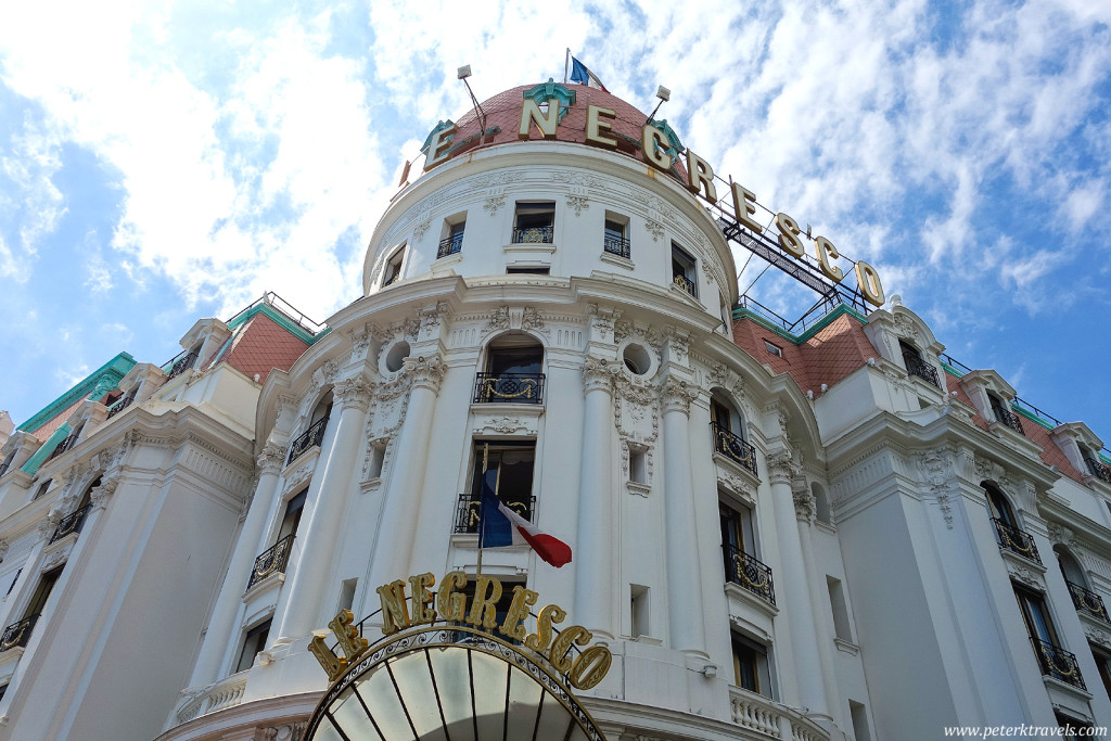 The Hotel Negresco sits across from the beach