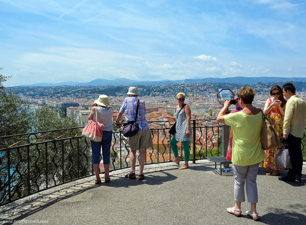 Tourists snap photos from the Colline du Chateau over look