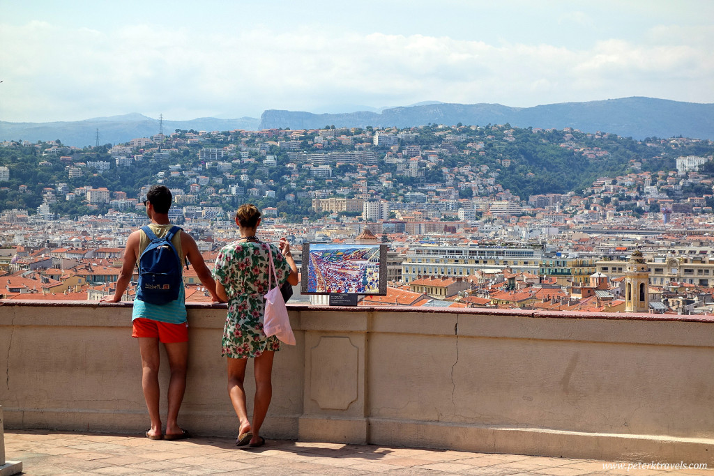 Tourists take in the view from one of the Colline du Chateau overlooks