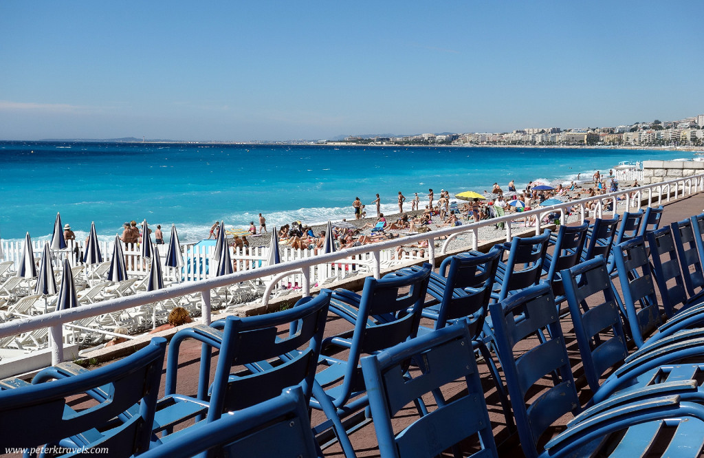 Blue chairs and beautiful water along Nice's Promenade des Anglais