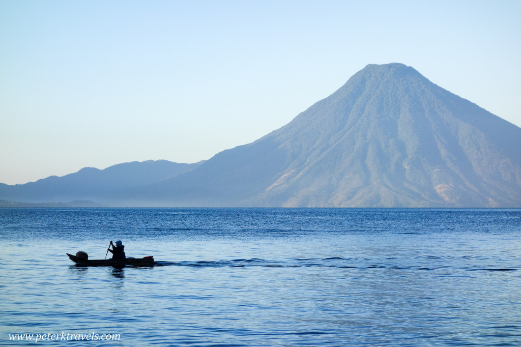 Early morning fisherman with Volcan San Pedro, Lake Atitlan, Guatemala