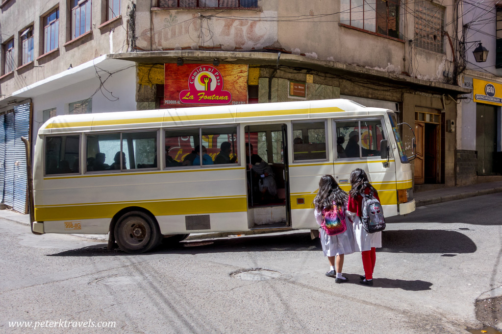 Students wait for a Nissan bus, Potosi