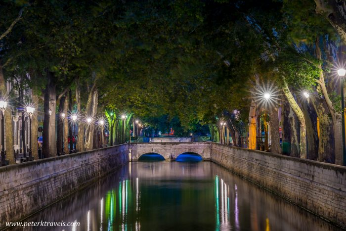Quai de la Fontaine, the canal in the center of Nimes, France.