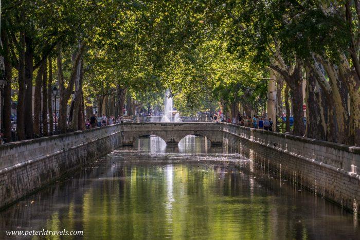 Quai de la Fontaine, the canal in the center of Nimes, France.